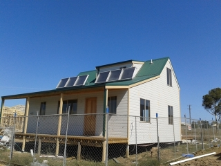 Solar heating system on new sustainable home for solar space heating