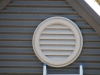 Vent cover for solar fan providing solar ventilation and roof cooling
