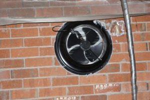 sub-floor fan in brick wall