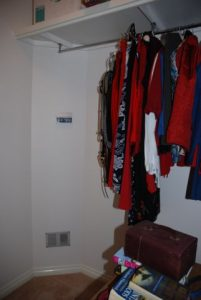 walk-in robe with clothes hanging